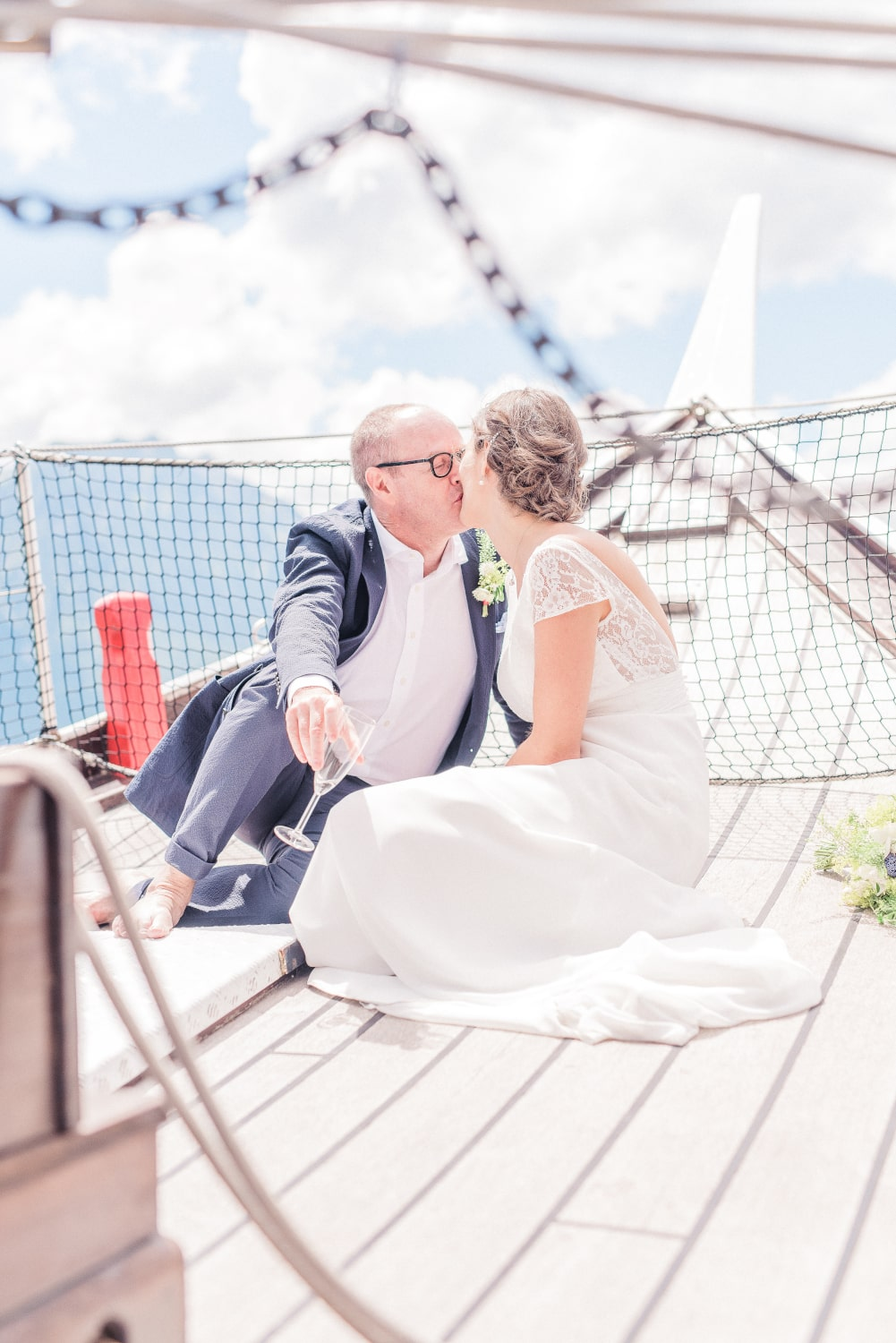 Couple kissing on a boat after their wedding ceremony