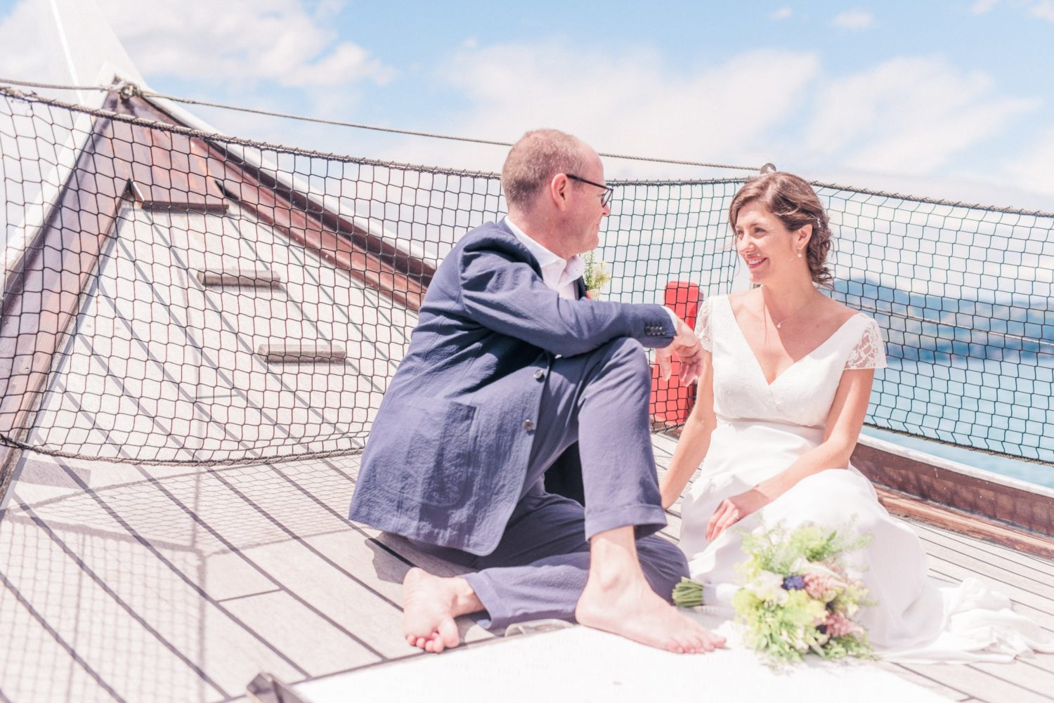 Barefoot couple during their wedding on a boat