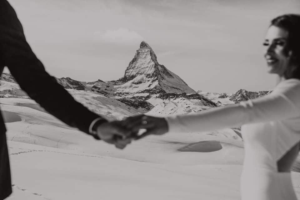 Couple hand in hand in front of Zermatt Matterhorn