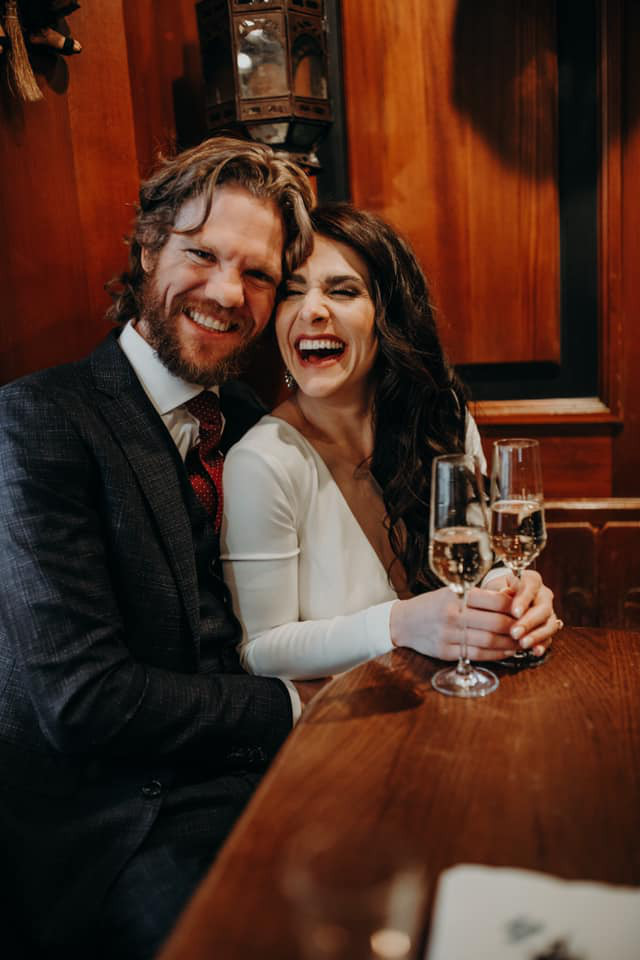 Couple drinking Champagne after their wedding