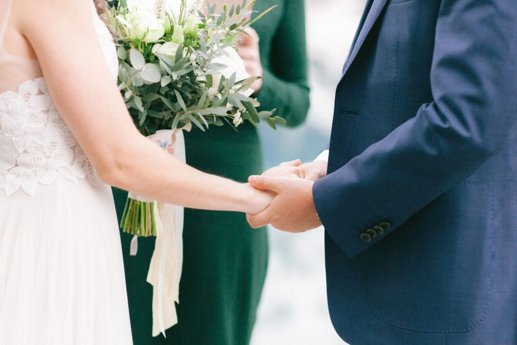 Couple holing hands during their wedding ceremony