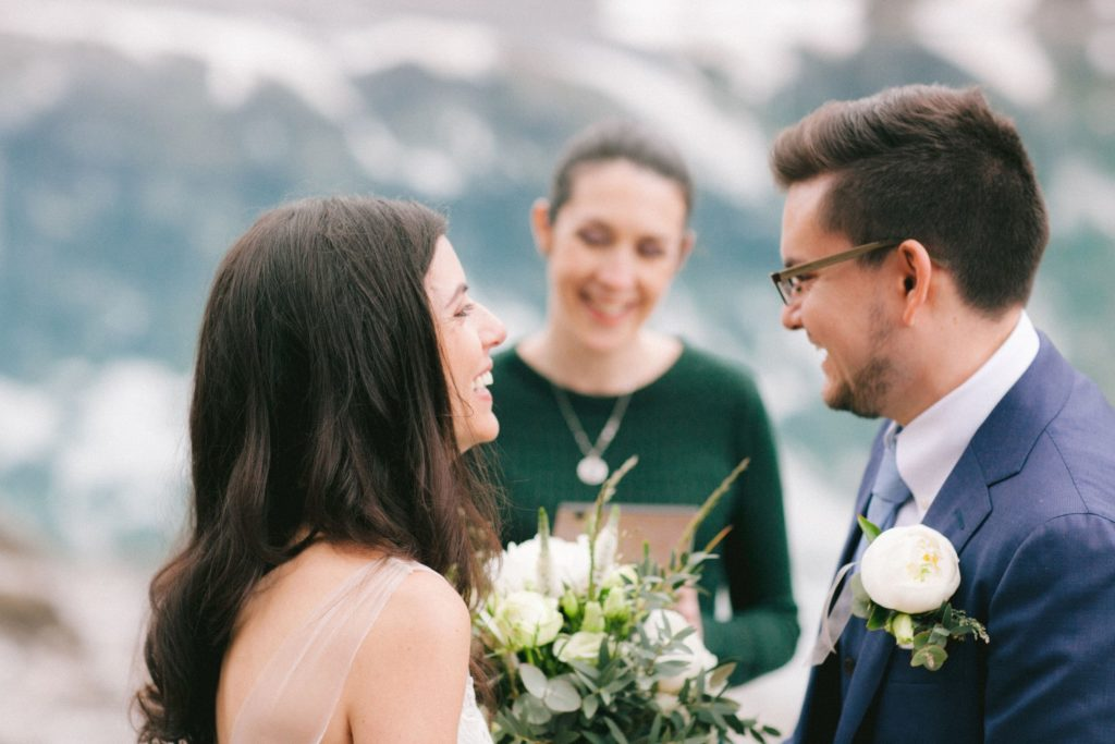 Couple smiling during their wedding ceremony