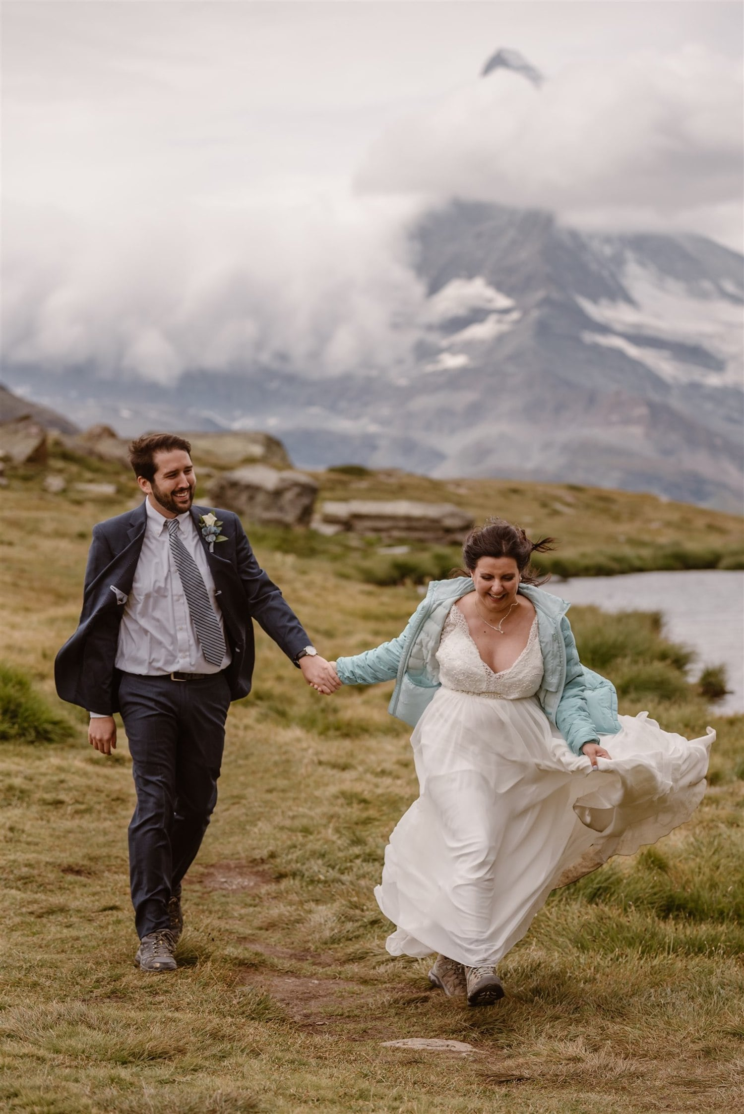 Bride and groom happily running in front of the Matterhorn