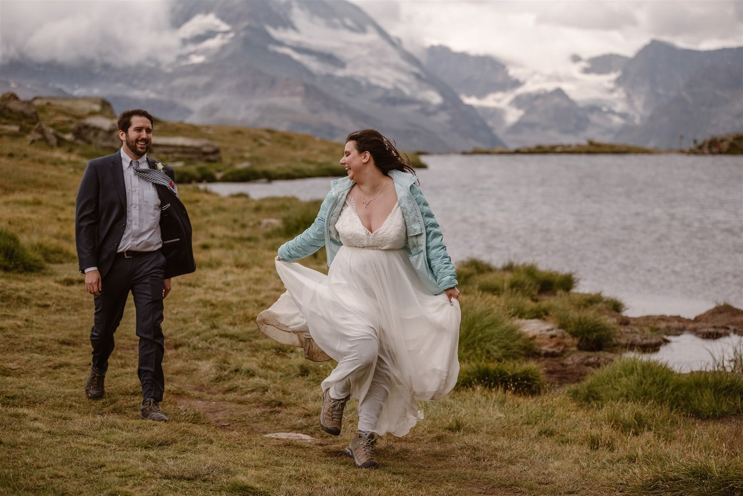 Couple running to their wedding ceremony in Switzerland