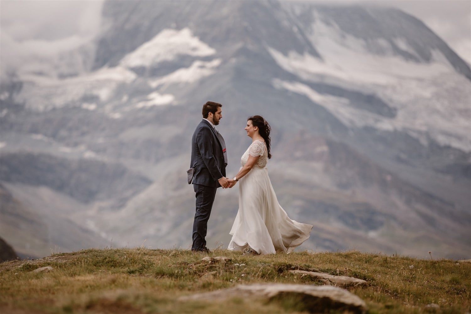 Newlyweds holing hands after their commitment ceremony in Zermatt