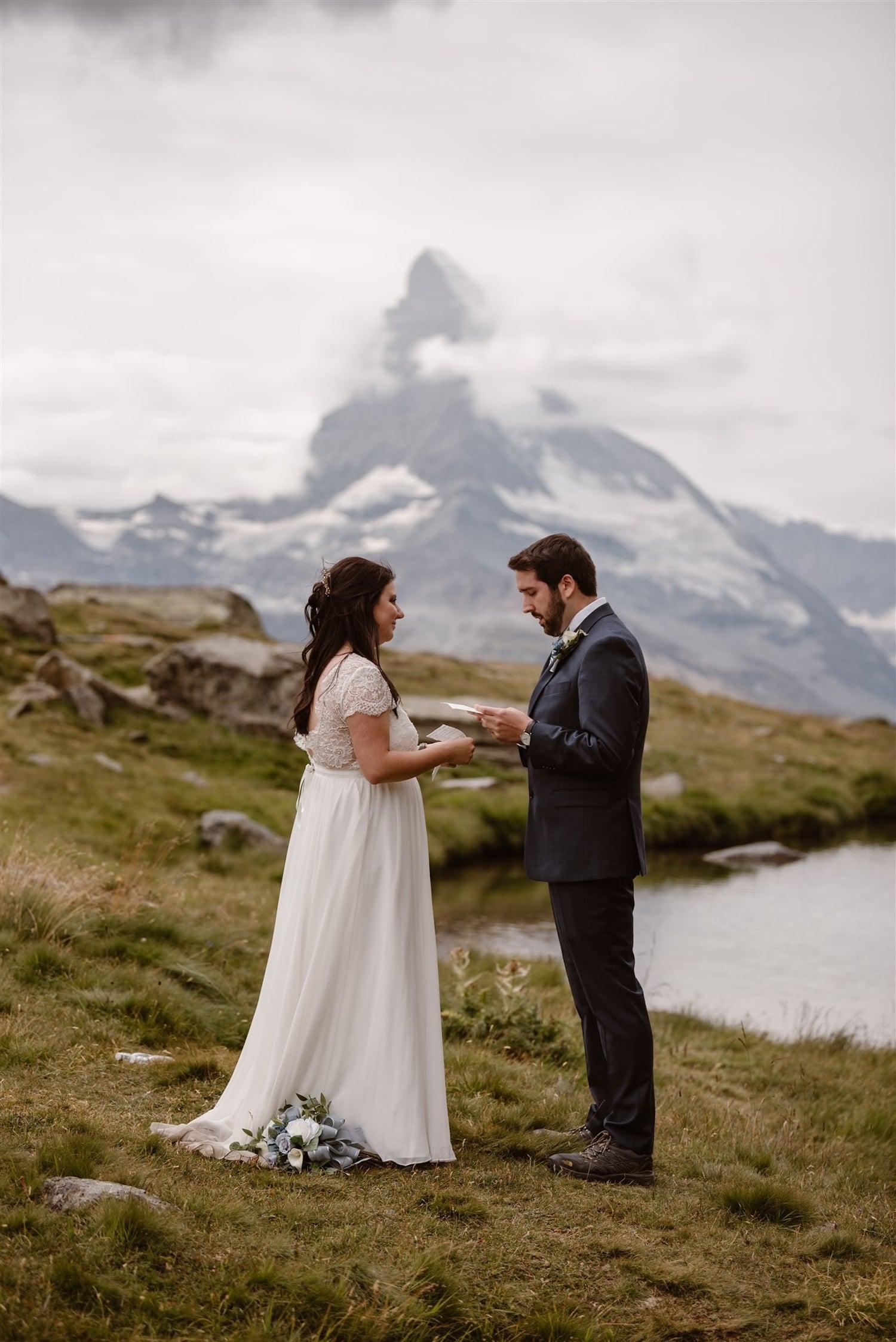 Couple exchanging vows in front of the Matterhorn in Zermatt