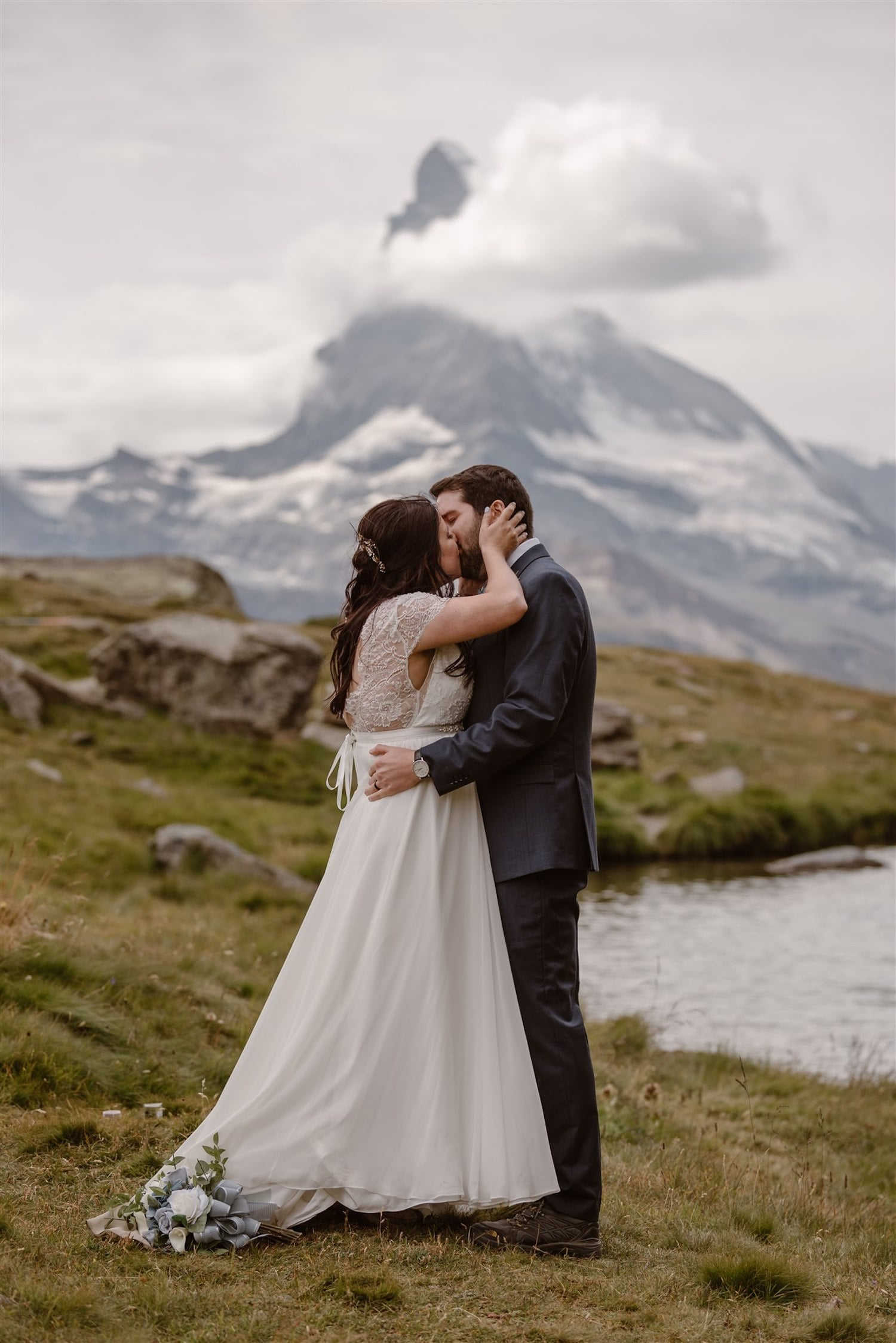 Newlyweds kissing in front of the Matterhorn