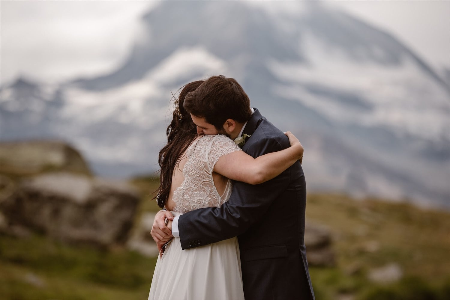 Newlyweds hugging after their marriage ceremony in the Swiss mountains