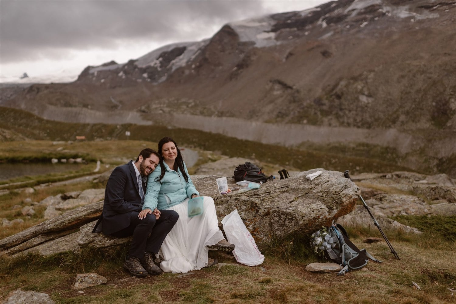 Newlyweds having picnic after their elopement ceremony in Zermatt