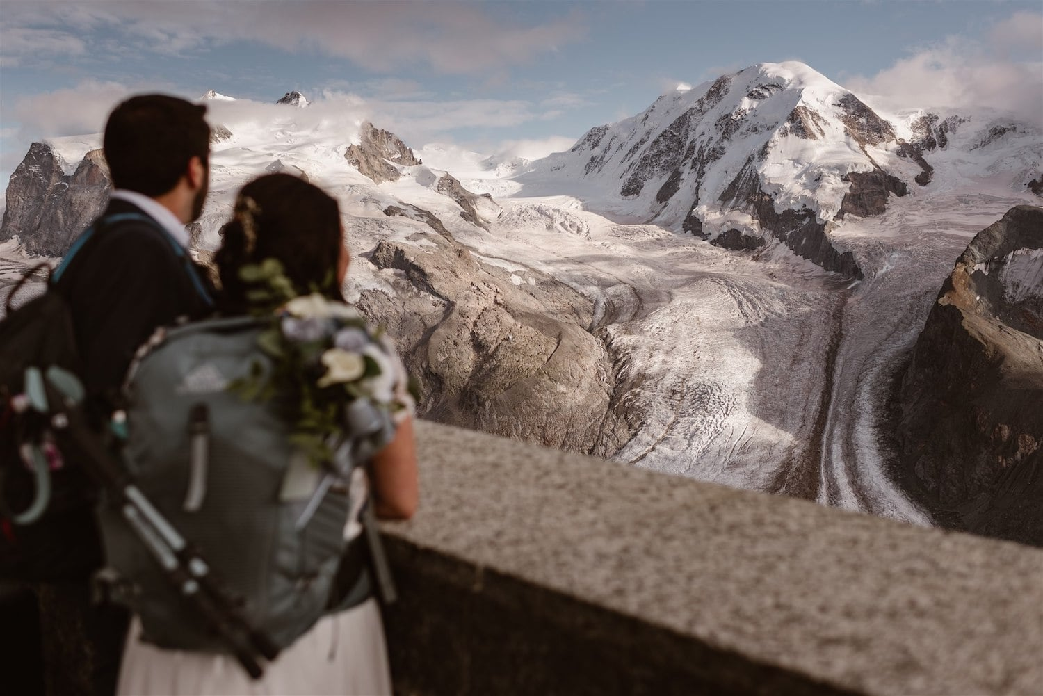 Couple looking at the mountain after their elopement ceremony in Switzerland