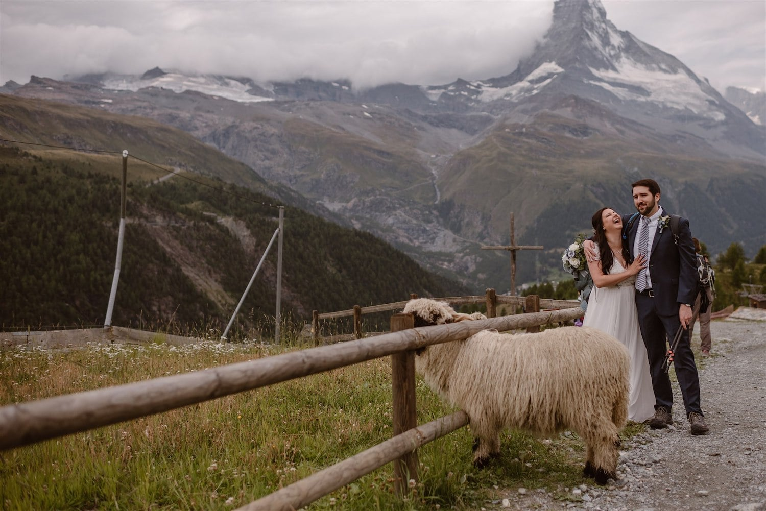 Lovers laughing and looking forward to getting married in front of the Matterhorn