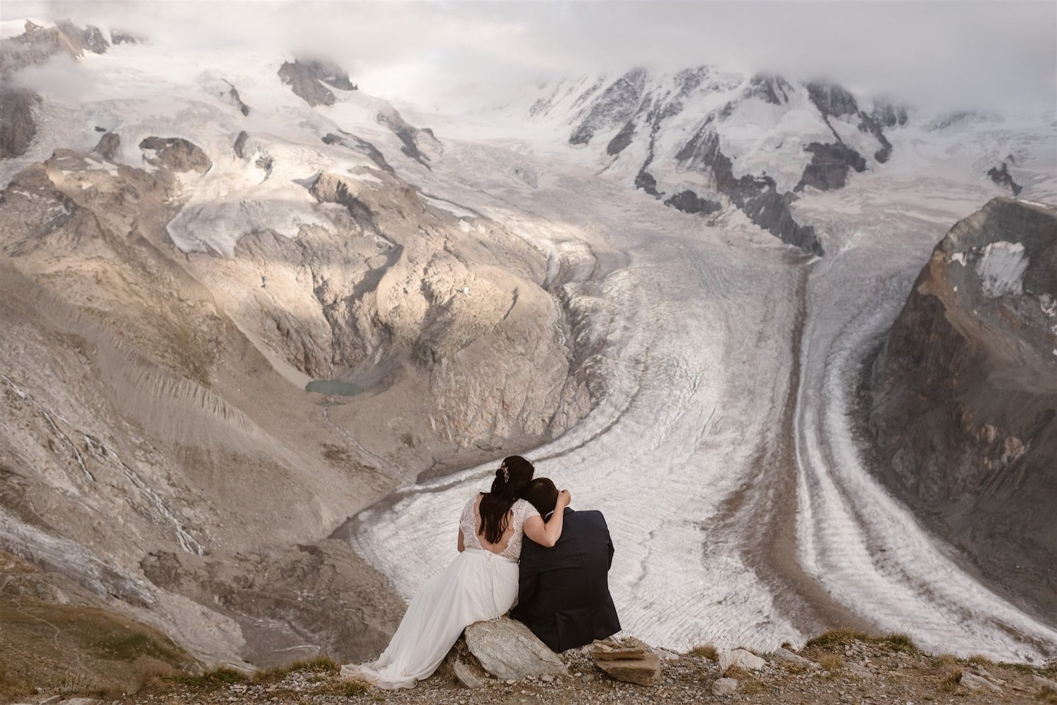 Couple looking at the mountain during their elopement in Switzerland