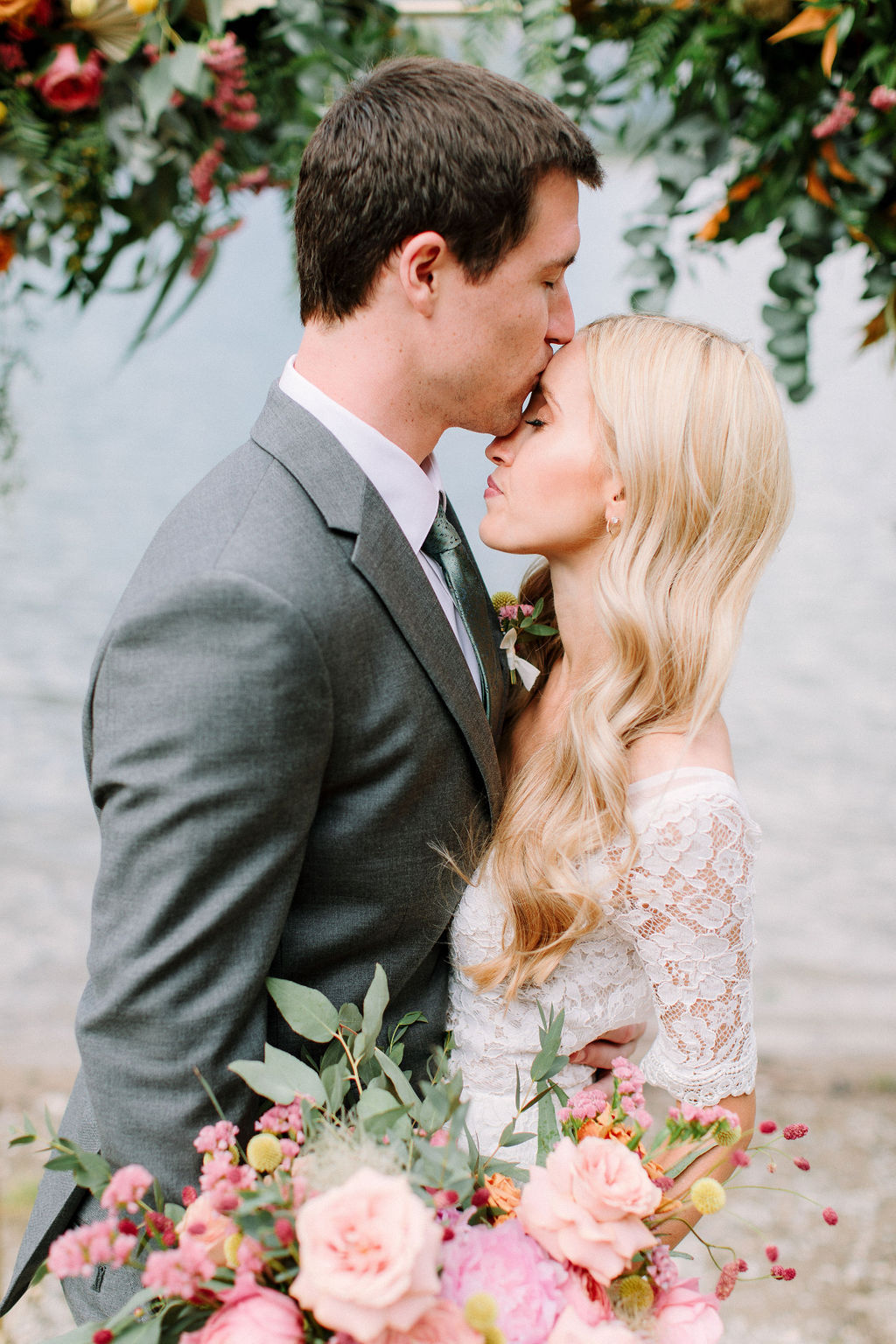 groom kissing bride after their elopement cermony